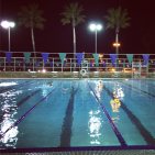 Early morning swimming under the lights (and palmtrees!)
